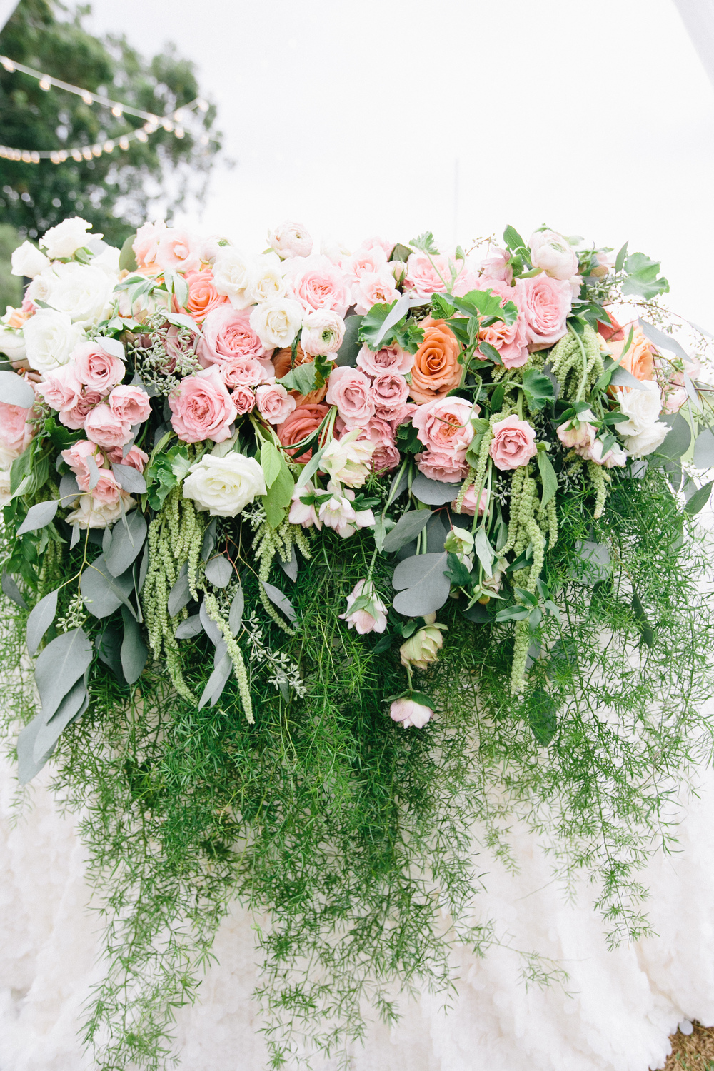 lavish coral and foliage sweetheart table by passion roots | pinky photography