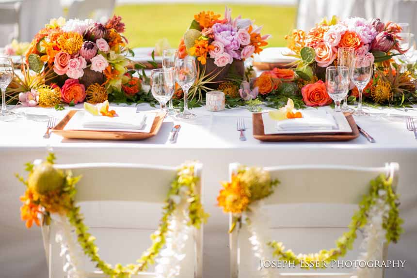 Bright and Tropical Sweetheart Table with Chair Swags by Passion Roots | Joseph Esser Photography | Oahu, Hawaii