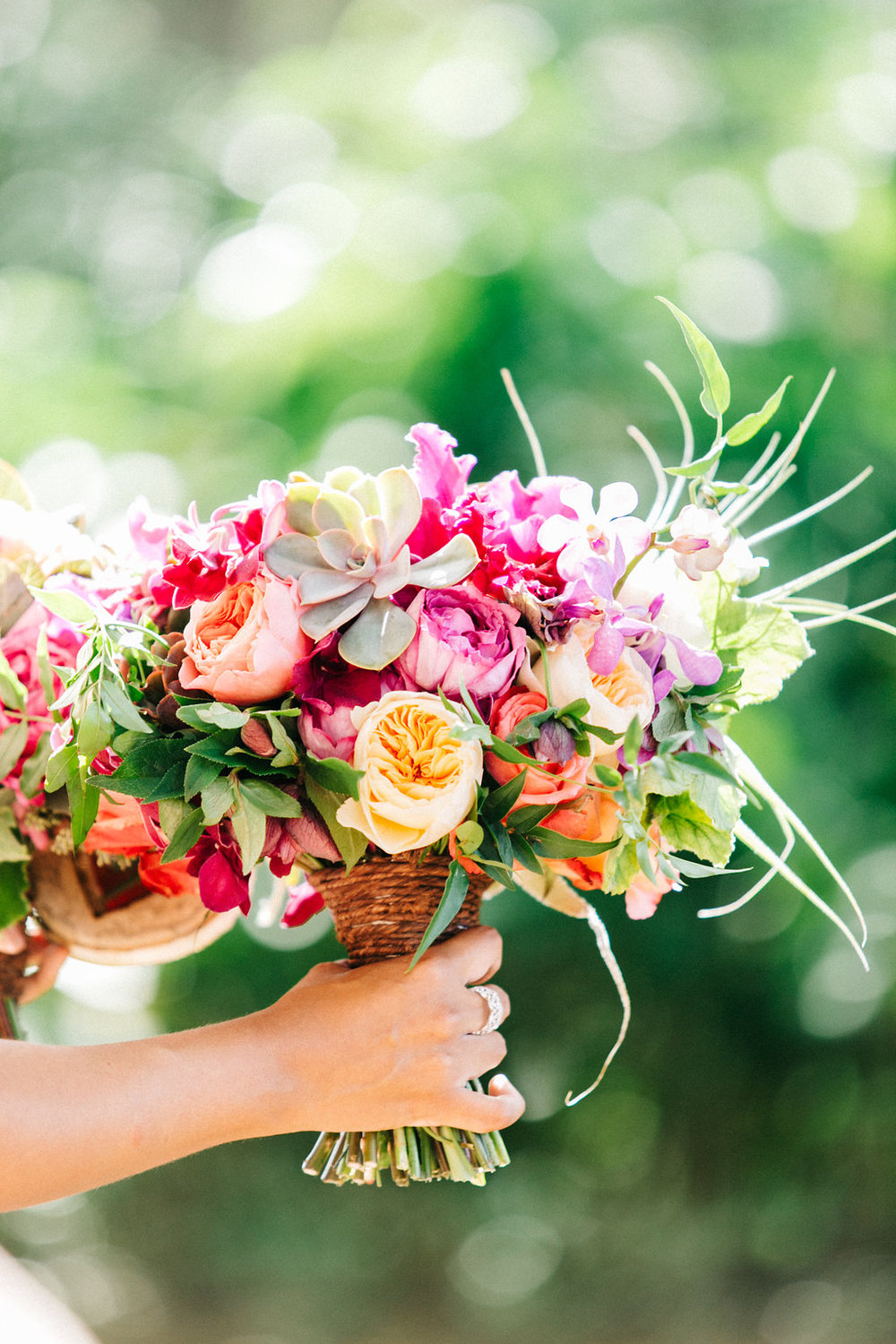 peach and pink hand tied bouquet | Lehua Noelle Photography
