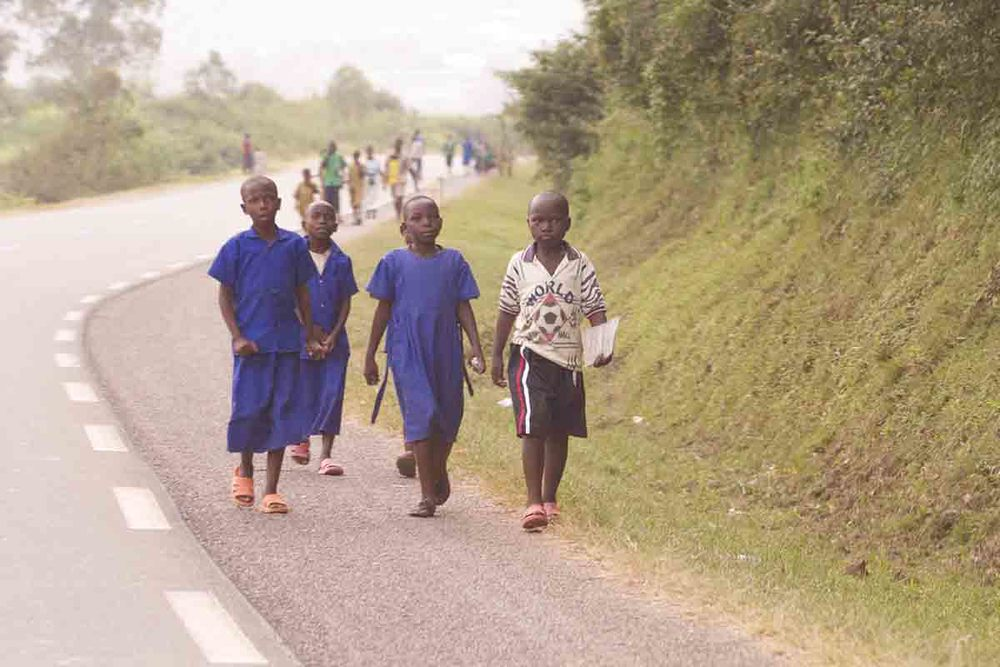 Children Walking to School Along Busy Road