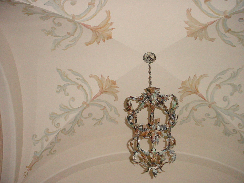 Painted patterns on groin vaulted ceiling