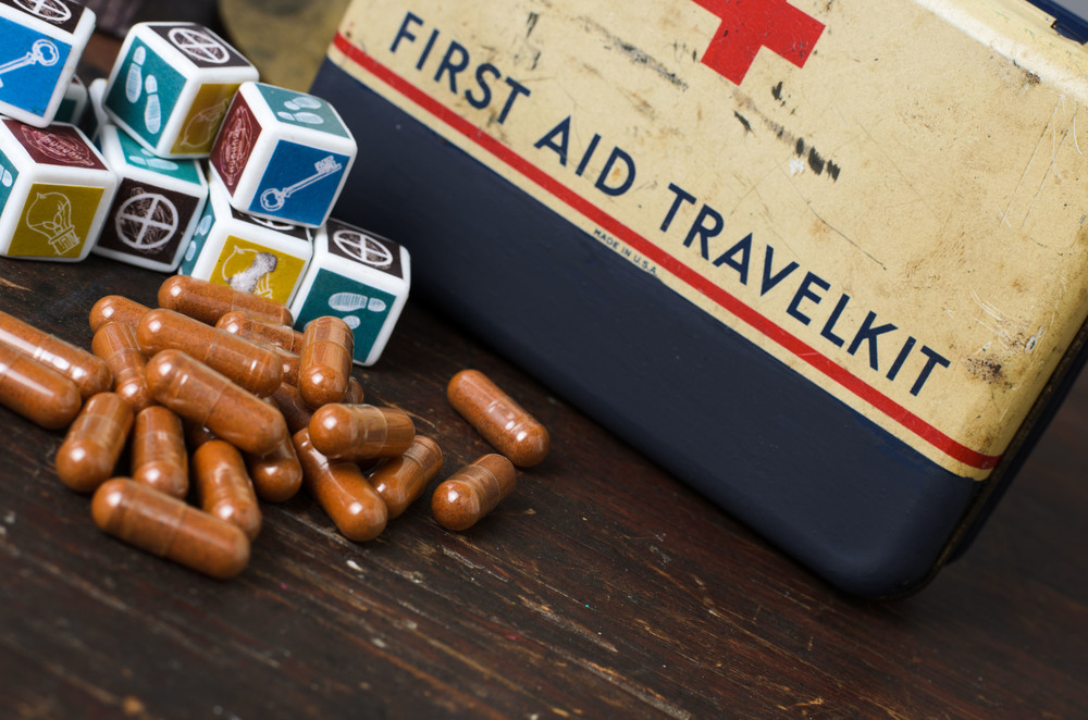 A player may get rid of medication by rolling the designated dice that are shown on the tile on which they have landed.
