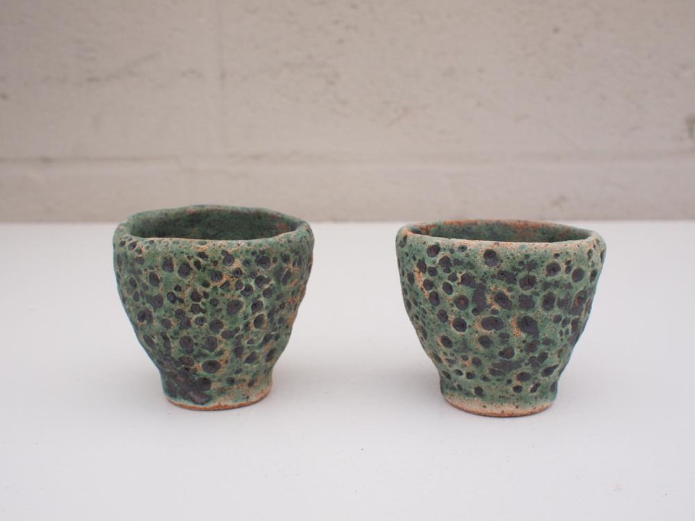 """#115, 116 Green meteor cups 2"""" h x 2.25"""" d $20/ea."""