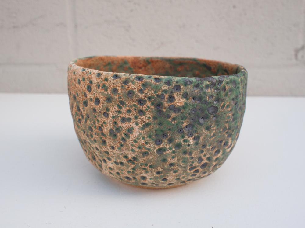 "#114 Mixed/green meteor pot 4"" h x 6"" d $60"