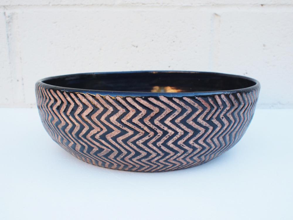 "#102 Black zigzag bowl 3.5"" h x 11.5"" d $150"