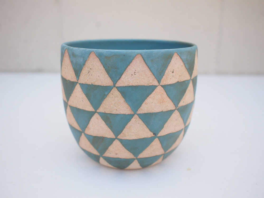 """#228 Turquoise triangle pot 4.75"""" h x 5.25"""" d $120"""