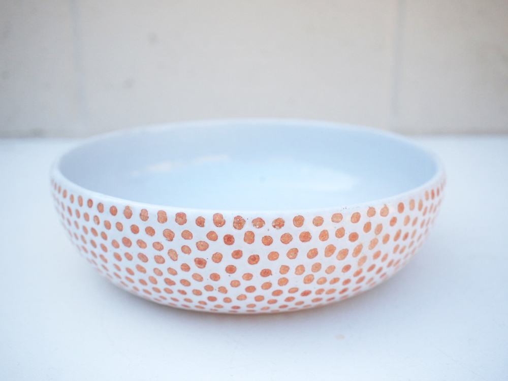 "#252 White spotted bowl 2.75"" h x 9.25"" d $125"