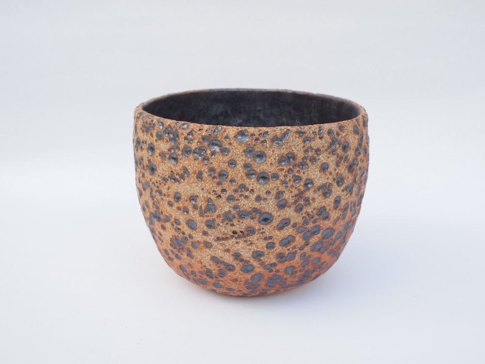 "#265 Natural meteor pot 4.5"" h x 5.5"" d $55"
