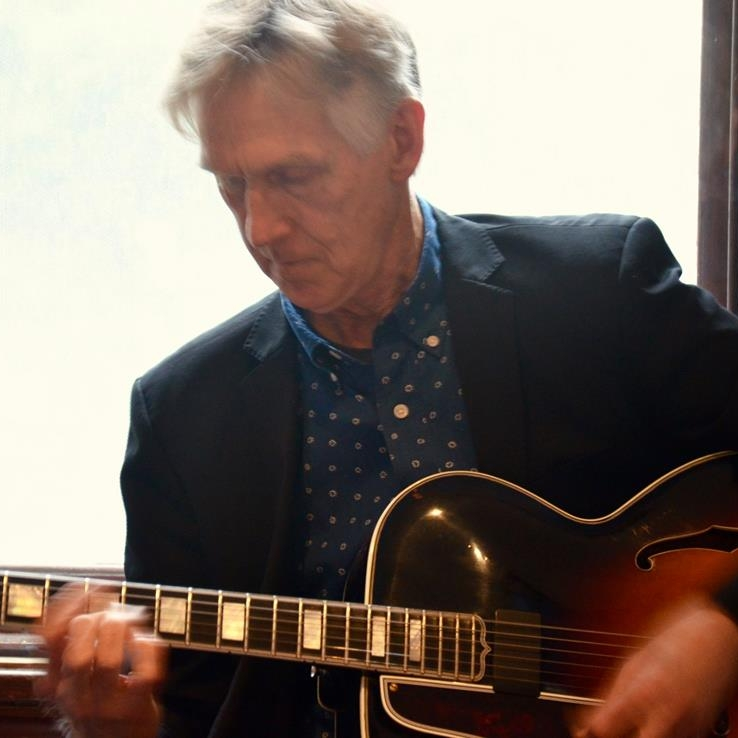 John Scurry on guitar