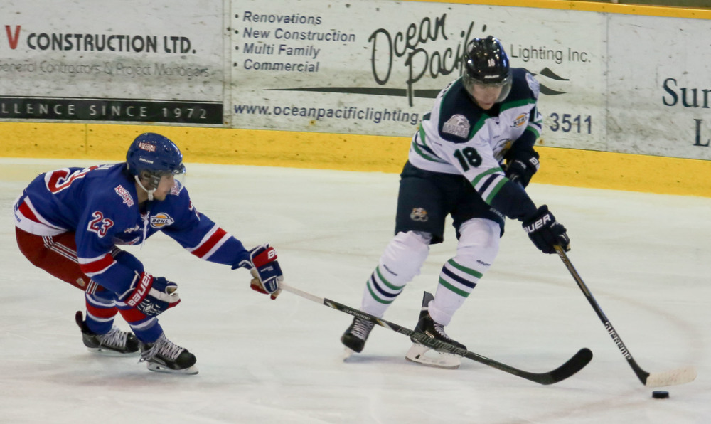 Quinn Lenihan (18) protects the puck against Prince George's Rider Stoglin during the Spruce Kings's 3-1 victory over the Eagles on Sunday, September 28th, 2014. Lenihan was exceptional in the game. (Photo by Lisa Drapluk.)