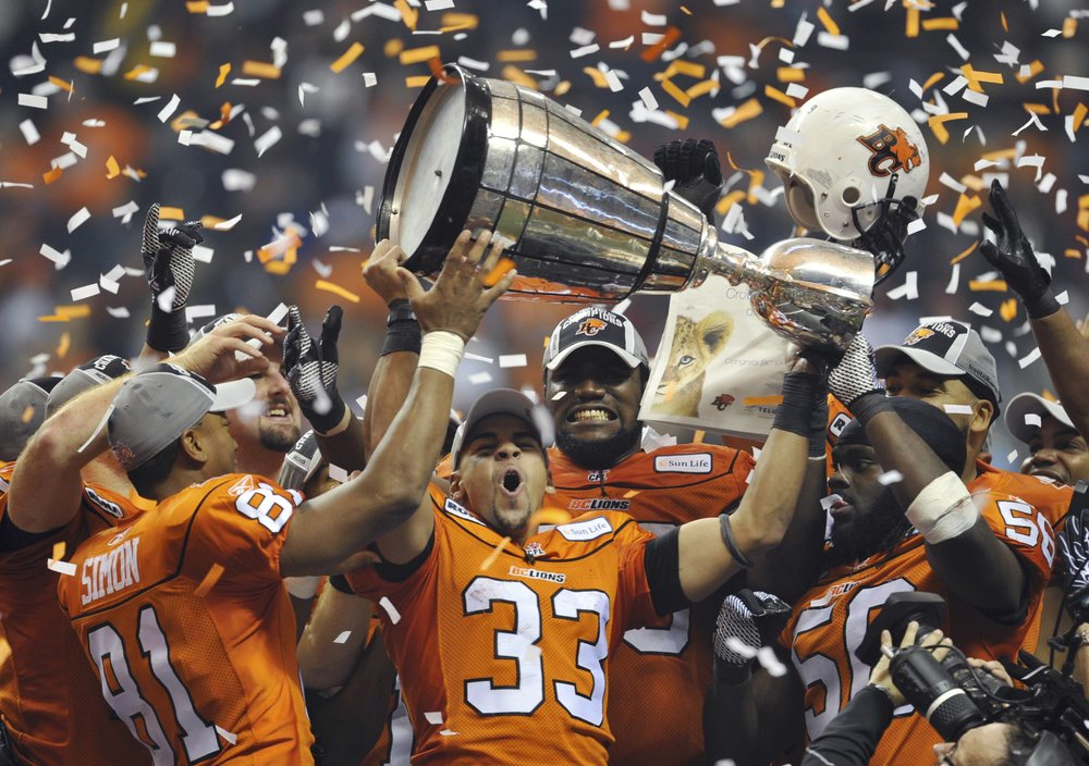 Andrew Harris (33) celebrates winning the 2011 Grey Cup with B.C., just one year removed from ruining Ryan's life.