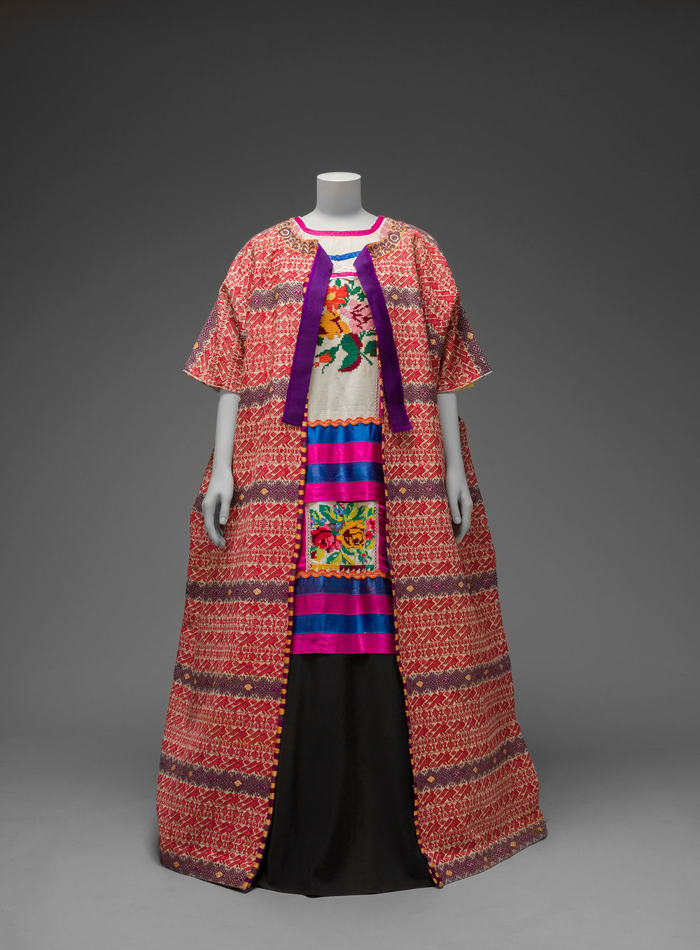 Guatemalan cotton coat worn with Mazatec huipil and plain floor- length skirt. Museo Frida Kahlo.  Both images © Diego Rivera and Frida Kahlo Archives, Banco de México, Fiduciary of the Trust of the Diego Riviera and Frida Kahlo Museums.