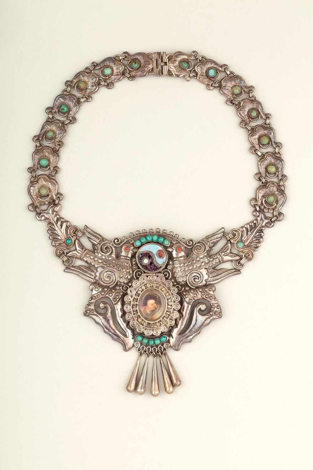 Necklace of silver, enamel, turquoise and coral with   hinged   compartment, made by Matilde Poulat, Mexico City, c.1950. Museo Frida Kahlo. Photograph Javier Hinojosa. © Diego Riviera and Frida Kahlo Archives, Banco de México, Fiduciary of the Trust of the Diego Riviera and Frida Kahlo Museums.