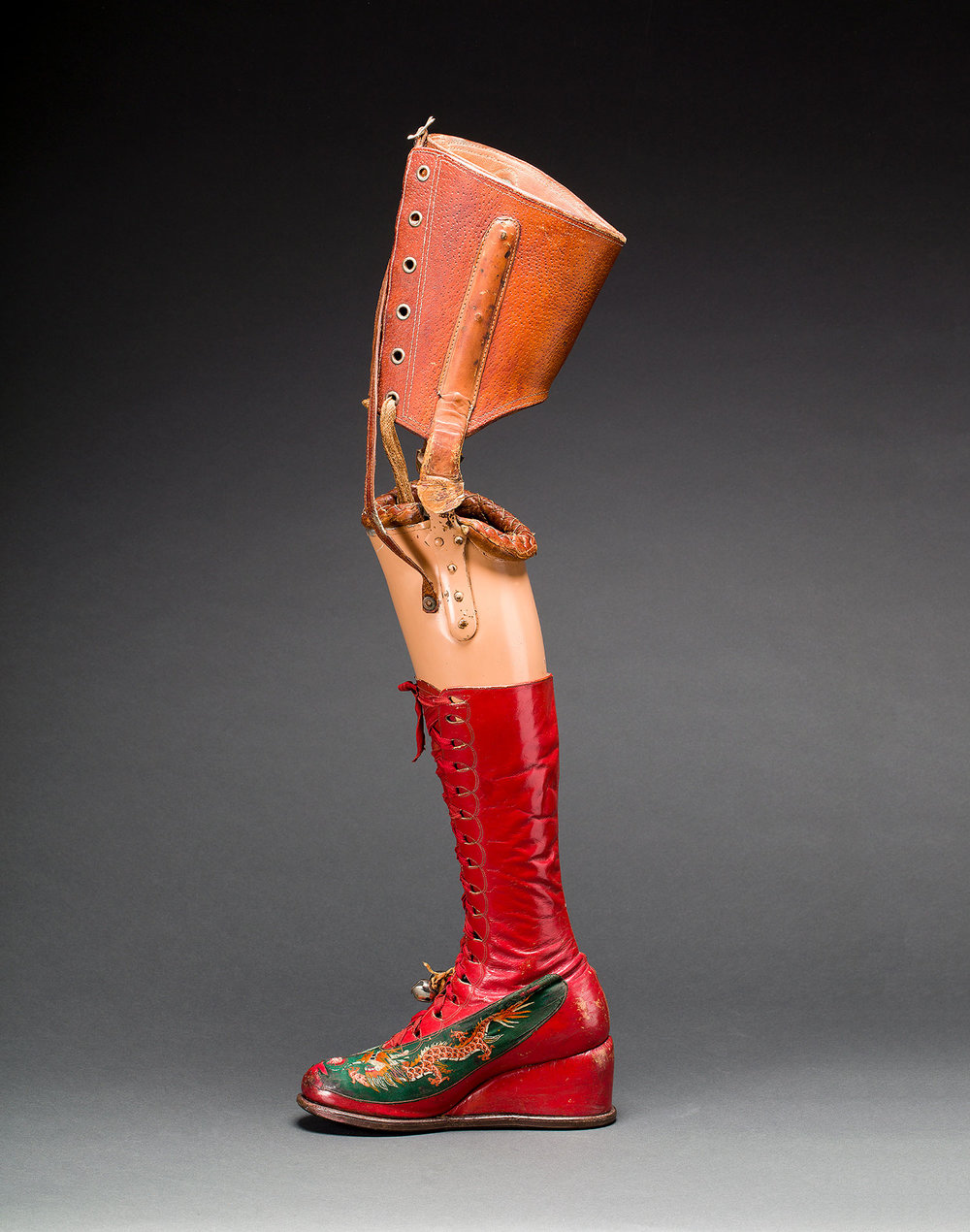 Image credit: Prosthetic leg with leather boot. Appliquéd silk with embroidered Chinese motifs. Photograph Javier Hinojosa. © Diego Riviera and Frida Kahlo Archives, Banco de México, Fiduciary of the Trust of the Diego Riviera and Frida Kahlo Museum