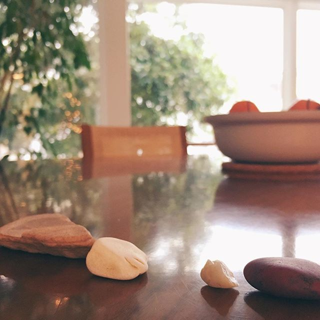 """I'm not sure who in our household is responsible, but I often wake up to mini rock art installations. Every single time, I think """"one day this will stop and I'll miss it."""""""