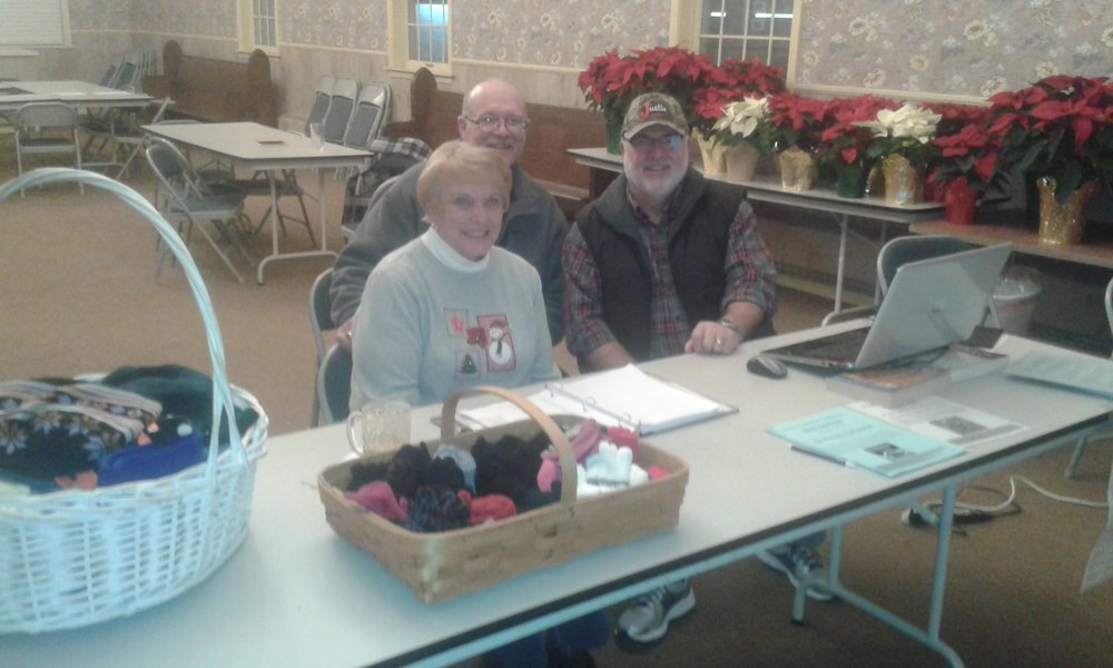 Karen Metsker, Rob Holl, and Fr. Thomas Haynes: NFP distribution day at St Thomas' Plymouth