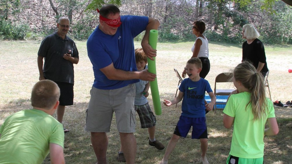 Fr. Rob Dorow having fun with the kids at the St. Andrew's by the Lake, Michigan City, Ice Cream Social (July 2018)