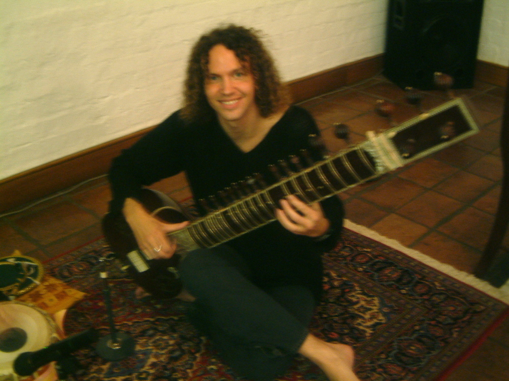 Rex, playing sitar at the book launch