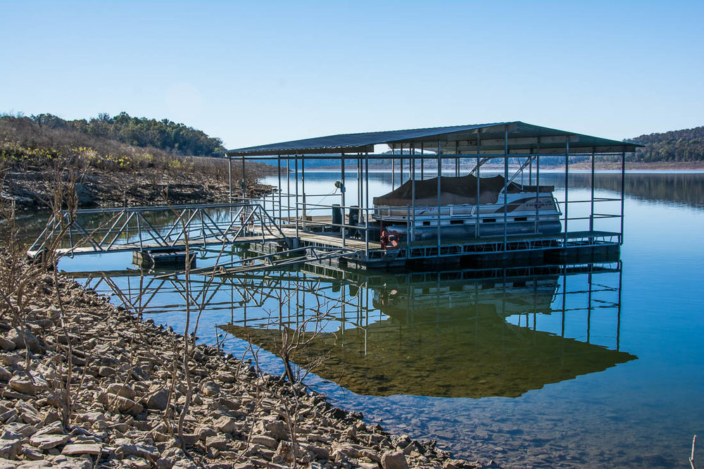 Bull Shoals Lake cabin with boat dock
