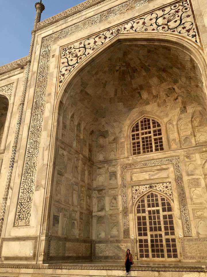 The massive scale of the Taj Mahal. The stone appears yellow because the morning sun had just risen and was shining directly on this side of the building.