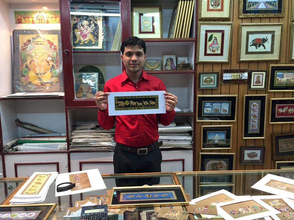 The artist surrounded by his work in the local co-op in Delhi