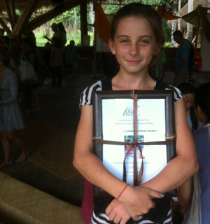 This is me in 5th grade holding a certificate of recognition for my gift to the school