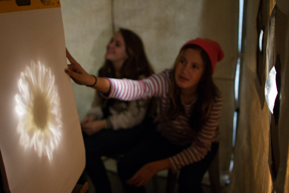 Inside our camera obscura at the Lower Eastside Girls Club.   Photo by Bryan Welch.