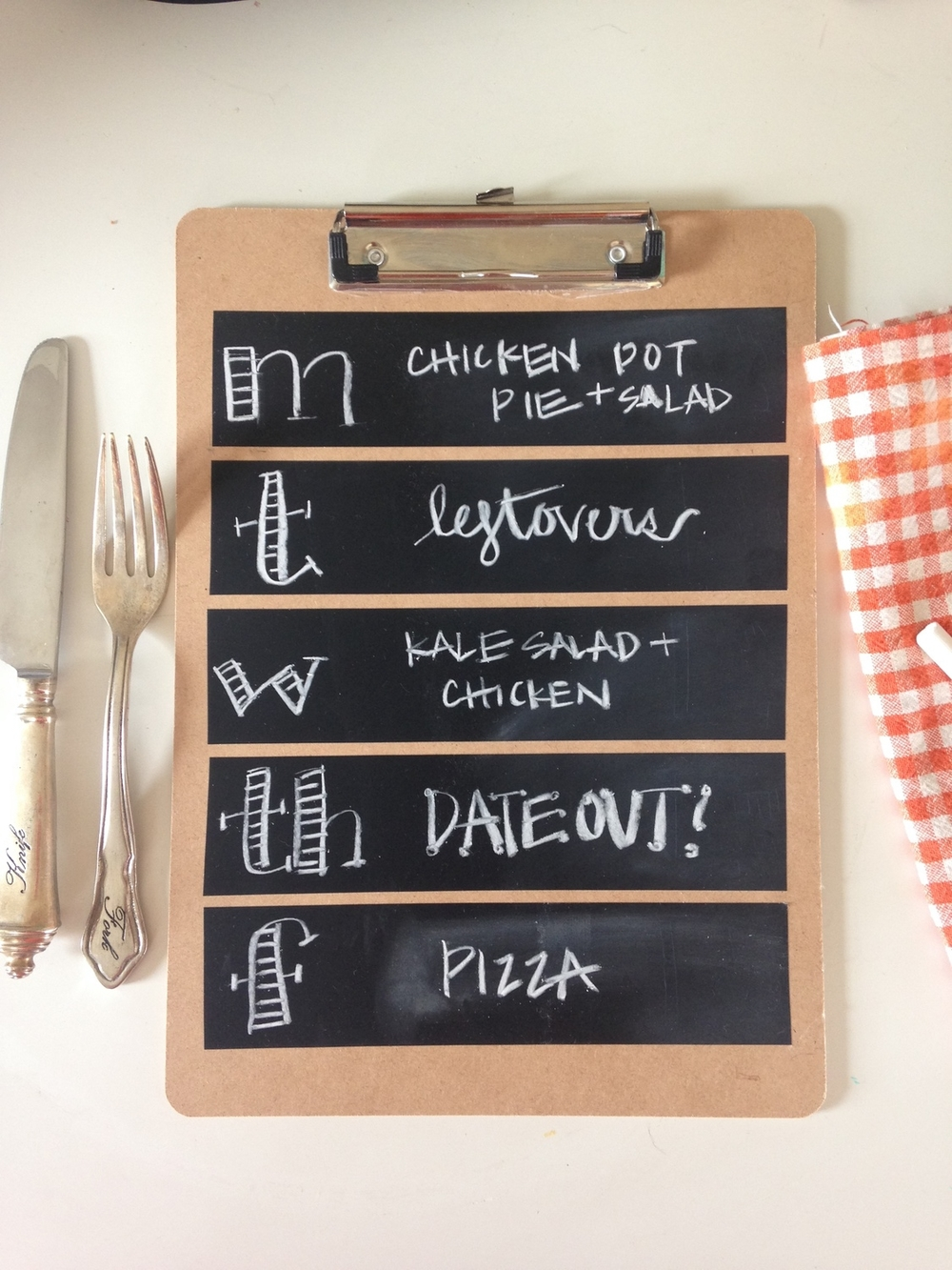 I'm trying to get better about keeping a calendar and having a weekly meal plan. The most simple way to keep myself on track is to write everything down! I used a clipboard I had in our office and cut out 5 equal length strips of chalkboard tape. I lined them up on top of each other to create '5 days'. Then I used chalk to write out each meal for the week. It helps my shopping list and and also helps my husband know what to expect.