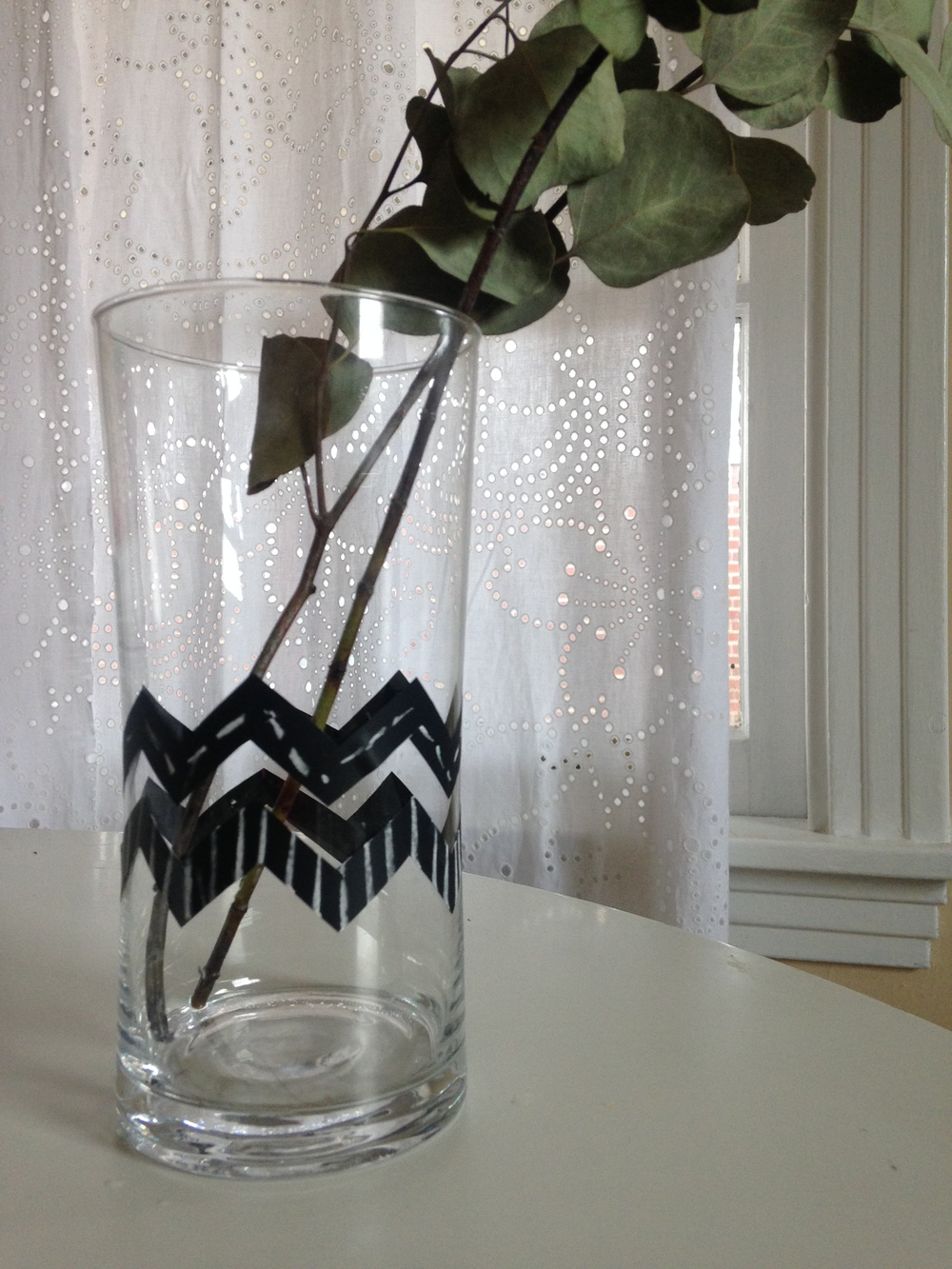 Ever need to doll up an existing vase or glass for something you're hosting? I do! You could do a million different designs using chalkboard tape. You could personalize vases with a name, note or quote. You could do a large scale design or even cut the tape in different designs. Lots of options with this one!