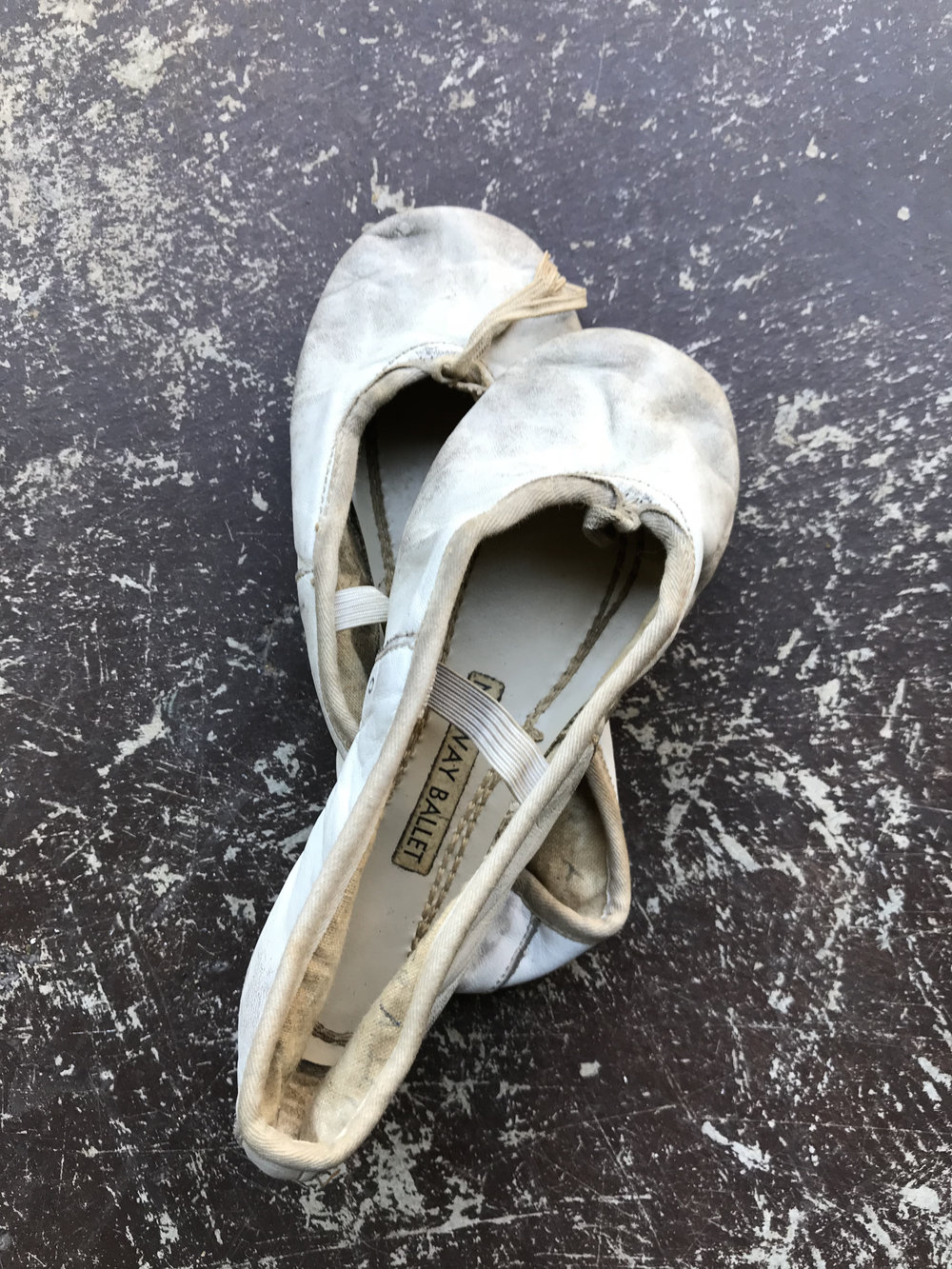 These were first. I was two years old when I first slipped them on. I didn't yet know right from left so they were perfect.    In time, ballet turned to track, slippers tossed for track shoes. Every athlete begins somewhere. That somewhere is the place you keep returning to, to regain your foundation, balance, strength. For years, for me, this foundation had always been ballet. If my speed was slack, I'd return to ballet. If my finesse was off, I returned to ballet. Until I stepped into yoga, and then yoga became ground zero.   What's your ground zero?  What brings you back to center?