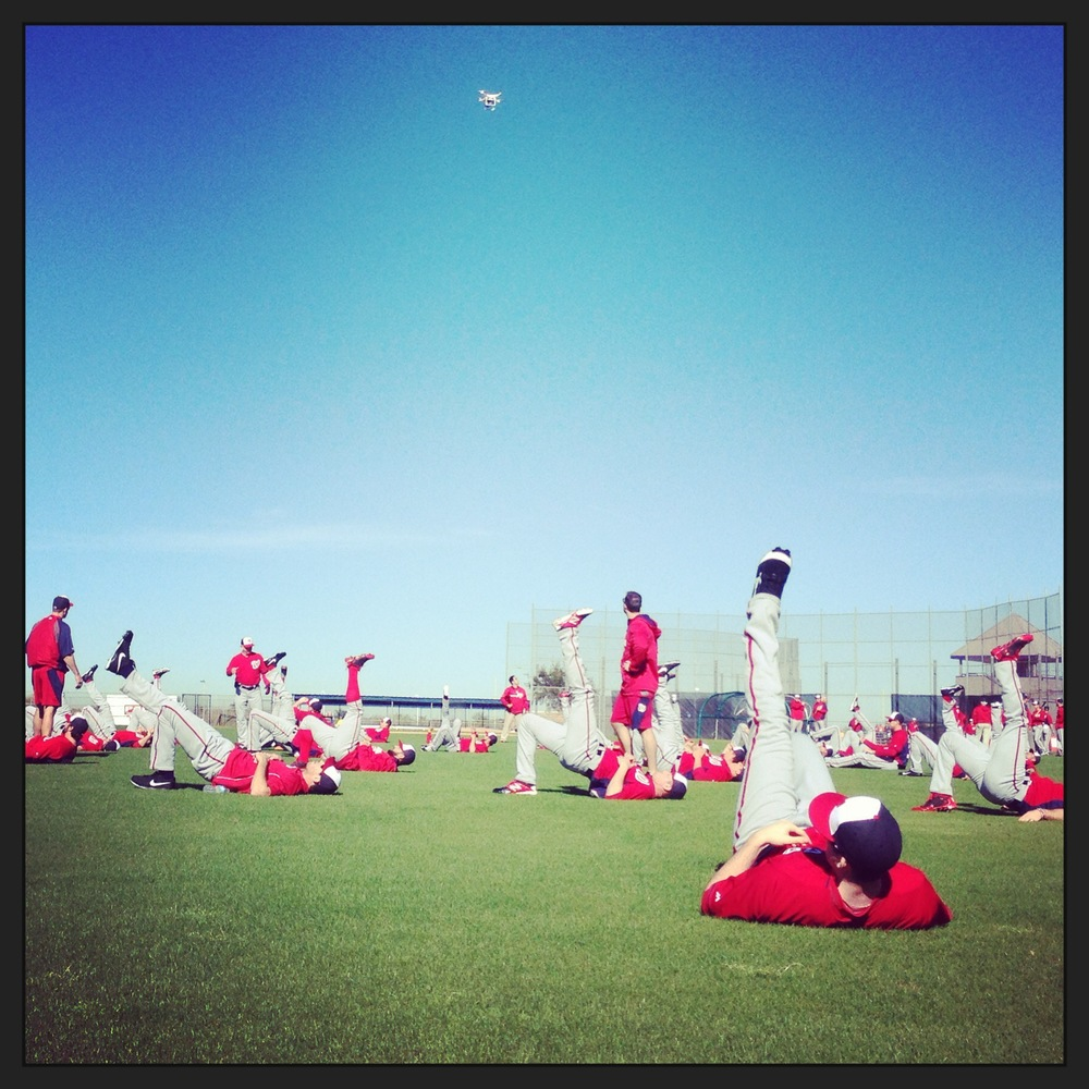 Players from the Washington Nationals check out a GoPro drone flying overhead during warmups on the second day of spring training in Viera, Florida on February 16, 2014.