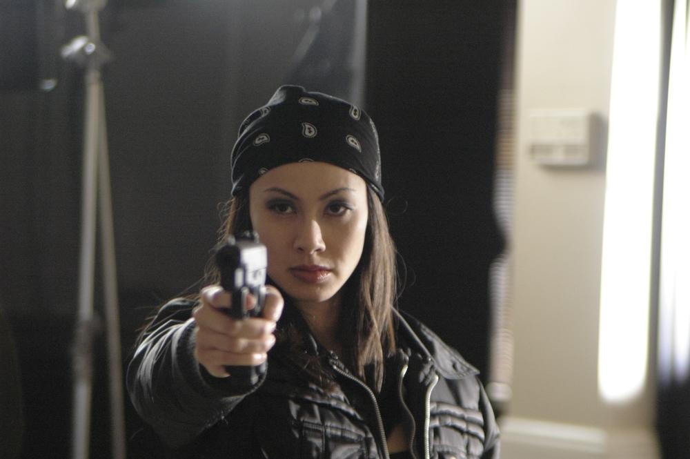 Janet Ling Posing with Gun