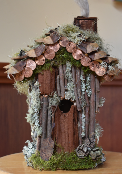 One of the class-designed birdhouses, available for bid at the auction.
