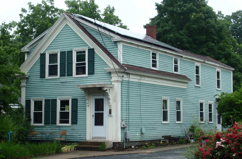 21 Hayden Rowe Street  - the Greek Revival cottage form which is found throughout Hopkinton Center