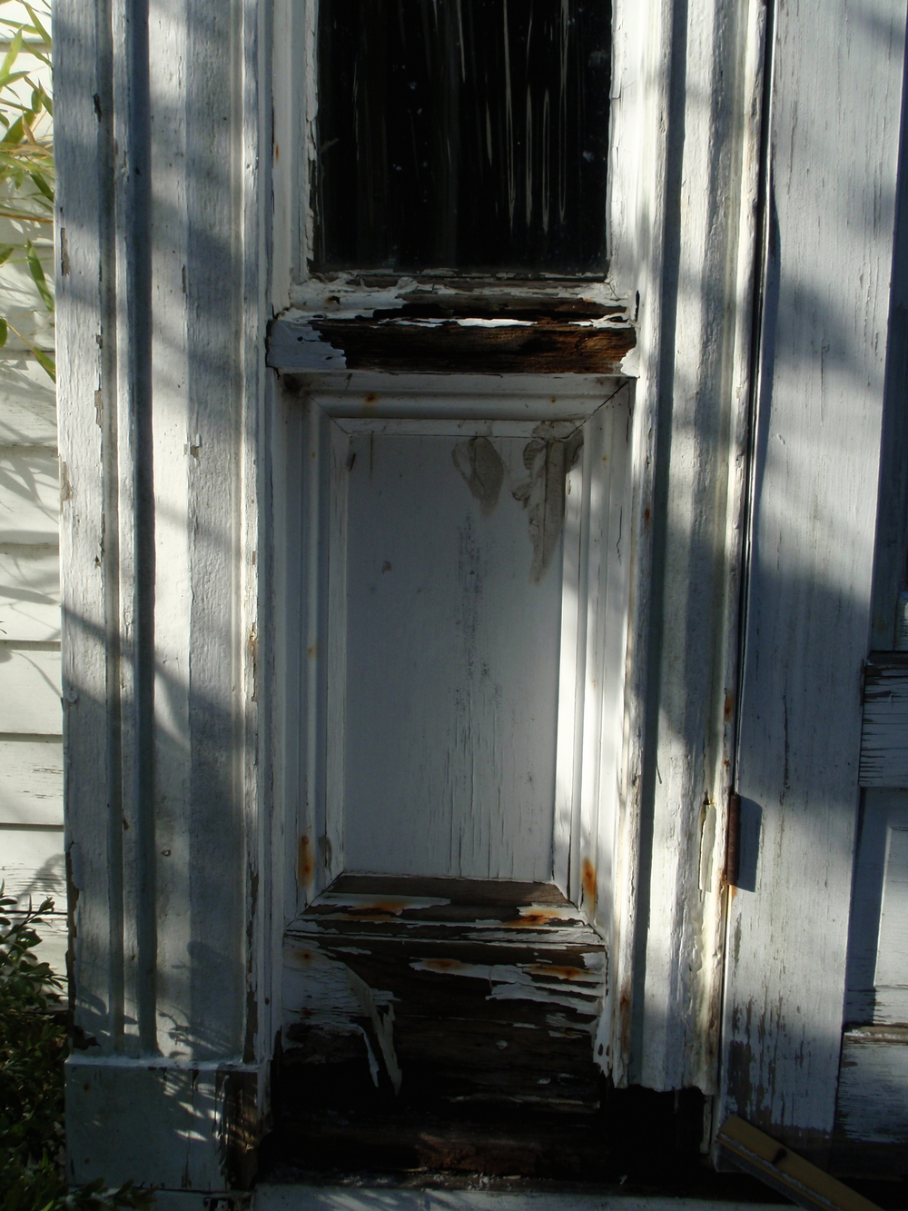 Paneling under the sidelights on the main entry, a common feature of Federal and Greek Revival style houses