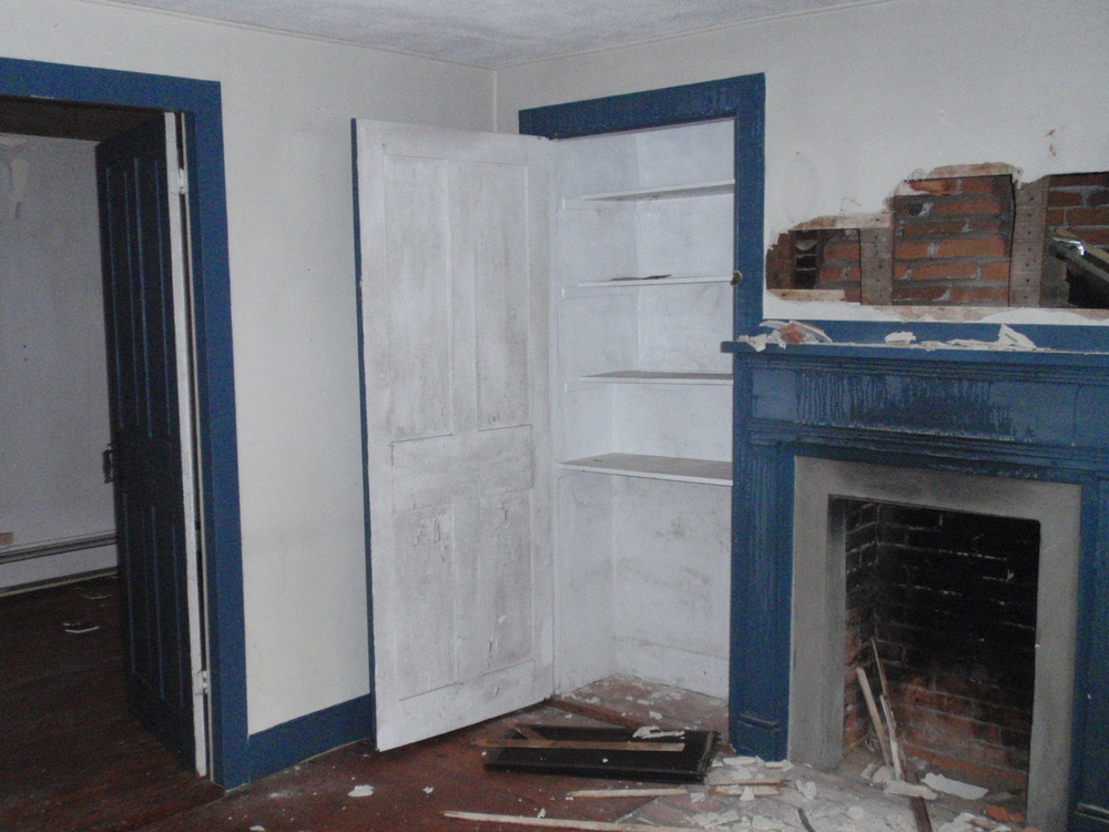 The fireplace and built-in closet in the parlor. This room was built to be a more formal space, as its fireplace was not built with a bake oven.