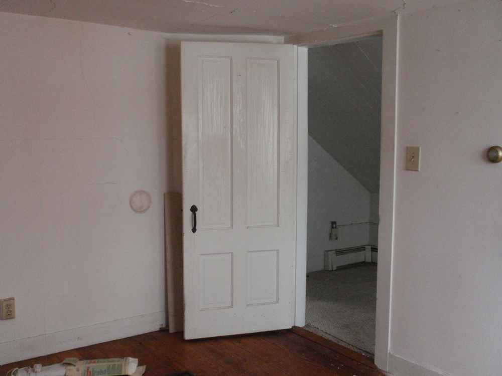 The east bedroom is the largest; looking from the bedroom into the upstairs hall.