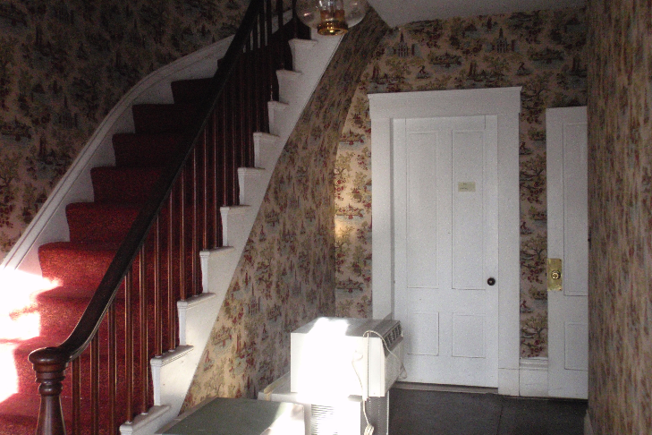 The main entry hall of the Spurr House was repapered in the 1970s. The paper is typical of patriotic designs that were common around the 1976 bicentennial.