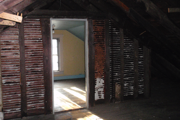 A small room at the front of the attic has been finished; this was likely living space for a servant.