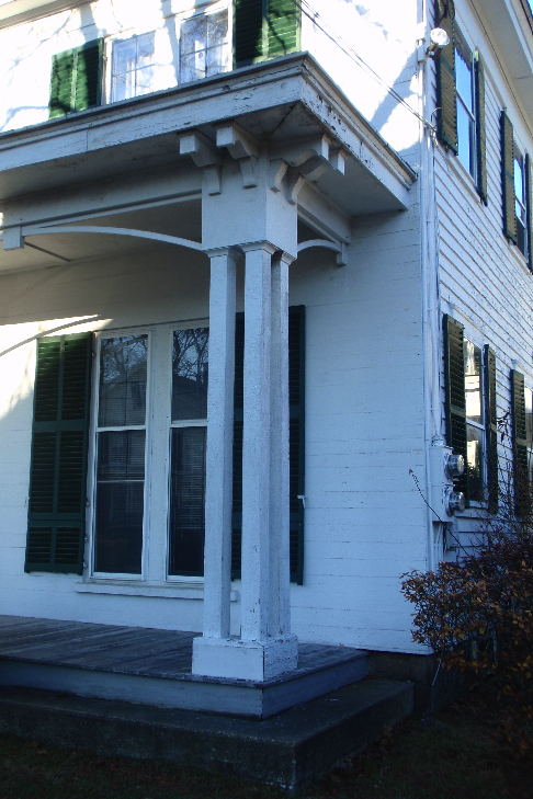 A detail of the front porch, which was likely added later in the 19th century, after the house was built. The front of the house is also distinguished by its ship-lap siding, in comparison to the more traditional clapboards on the rest of the building.