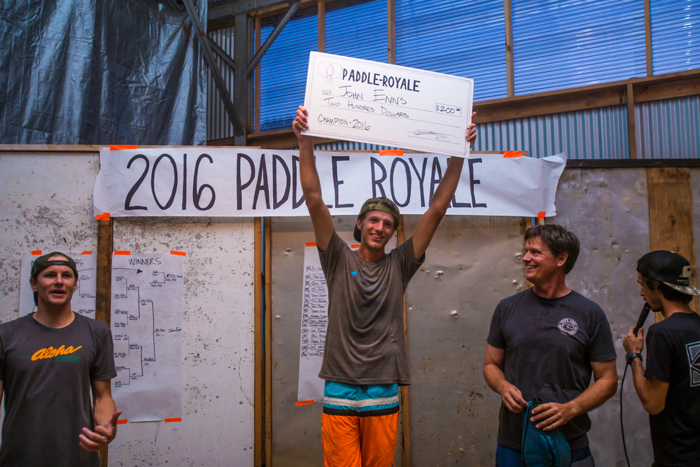John Enns claiming his prize and title as the Paddle-Royale Winner!