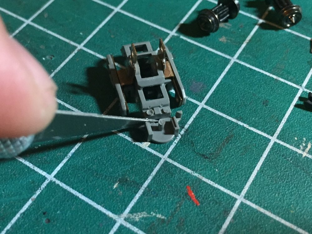 Step 9 - 1. Remove the wheels by slightly pulling apart the truck side frame.2. Carefully cut off the coupler box. Do not trim past the wall separating the wheel well and the coupler box. (See below for example)