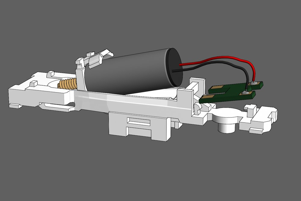 Step 4 - Place the motor into the frame. Orient it so the circuit board sits exactly as seen in the illustration.