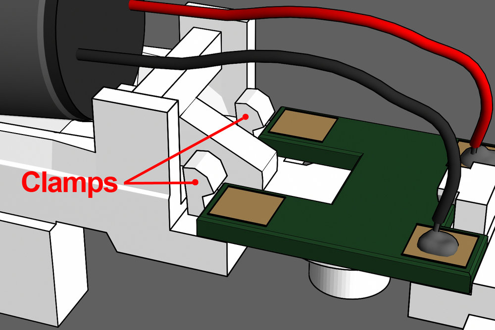 Step 8 - Push the board down past the clamps that sit behind the motor. Pliers can be used to squeeze each side of the board until it sits flat on the frame.If the sides of the circuit board protrude out the sides of the frame, sand the board so that it is flush with the side of the frame.
