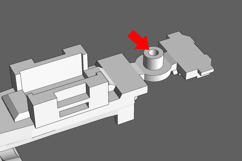 Step 1 - Locate the hole under the frame that will hold the Shorty's truck screw. Use a #00-90 tap to thread the hole for the screw.