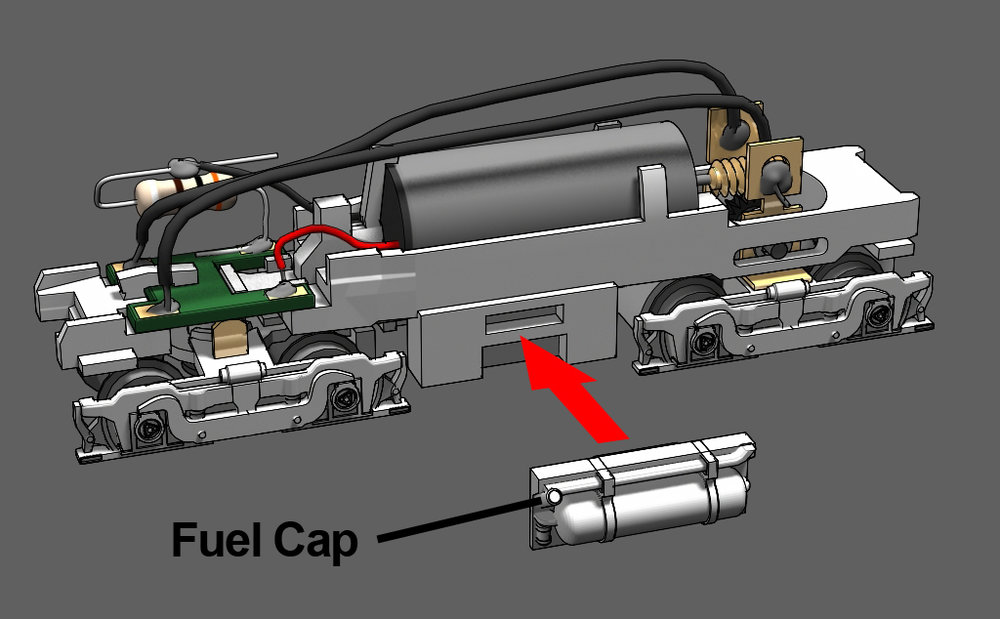 Step 23 - Snap the fuel tank into place. Glue is optional. There are left and right fuel tanks. Orient the fuel tanks so the the fuel cap is at the rear of the tank. The fuel cap should be next to the unpowered truck.
