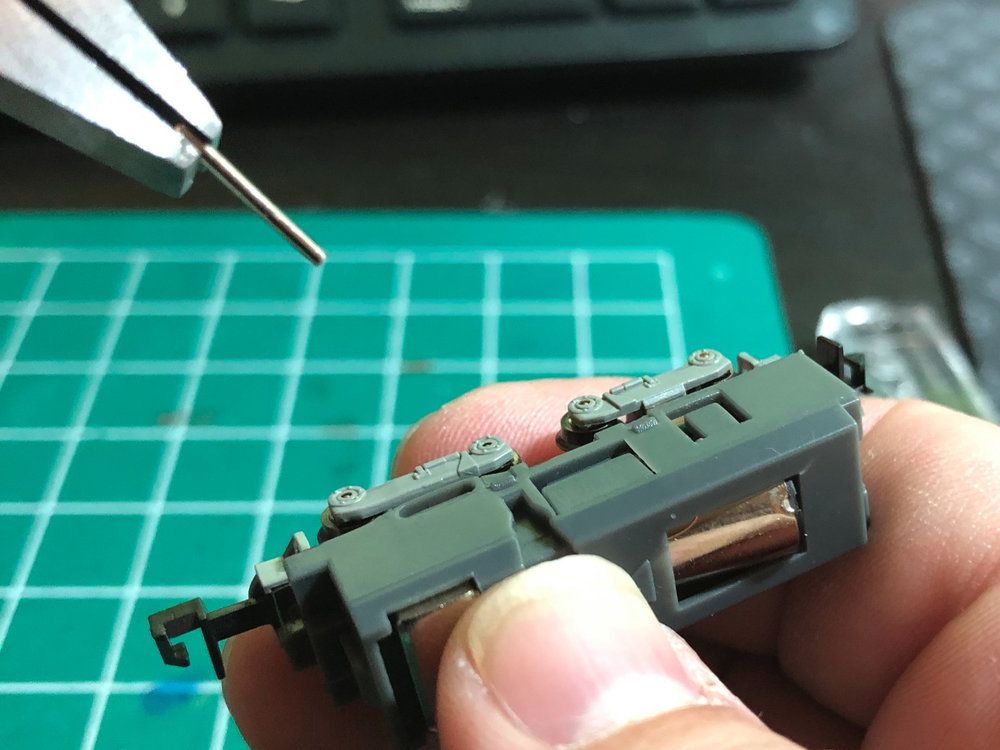Step 2 - Pull the pin out from the other side with pliers or tweezers.