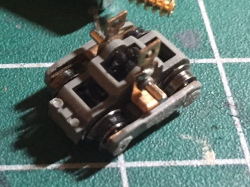 Step 10 - Put the black gear and the metal pin through the truck to keep it safe for storage.Pull the wheels and axles from the unpowered truck and place them aside.Repeat steps 1 to 10 for the second shorty.