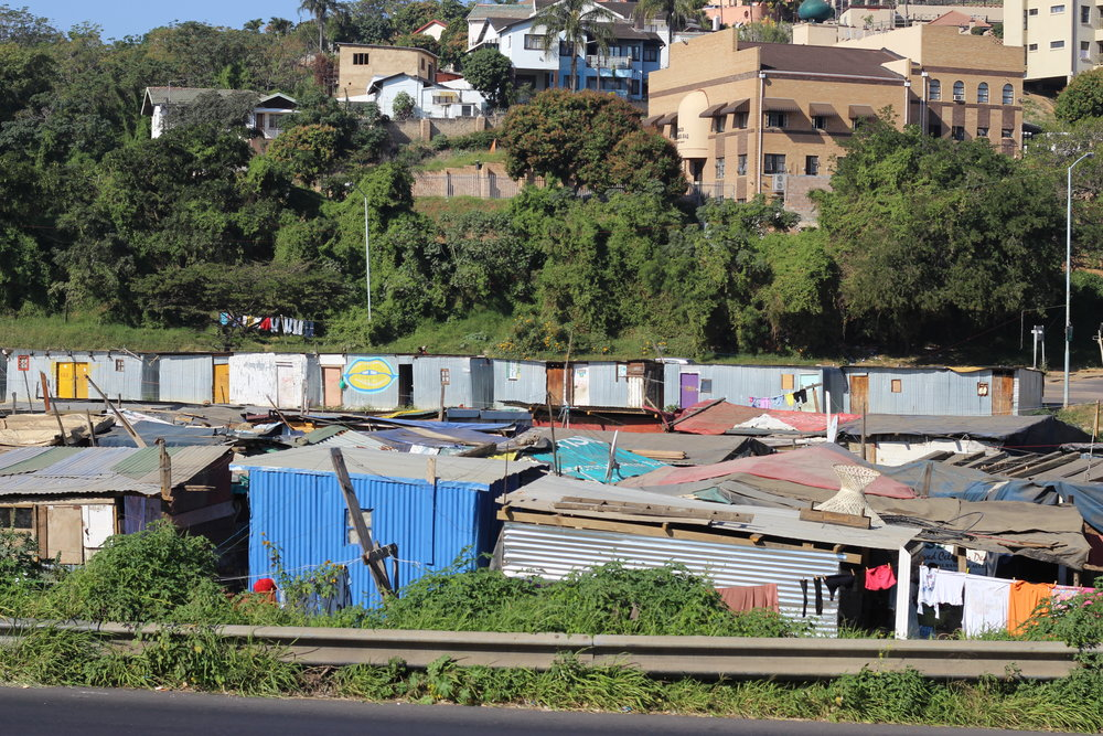 he town's people efficiently use their scarce resources to create dwellings for them and their loved ones