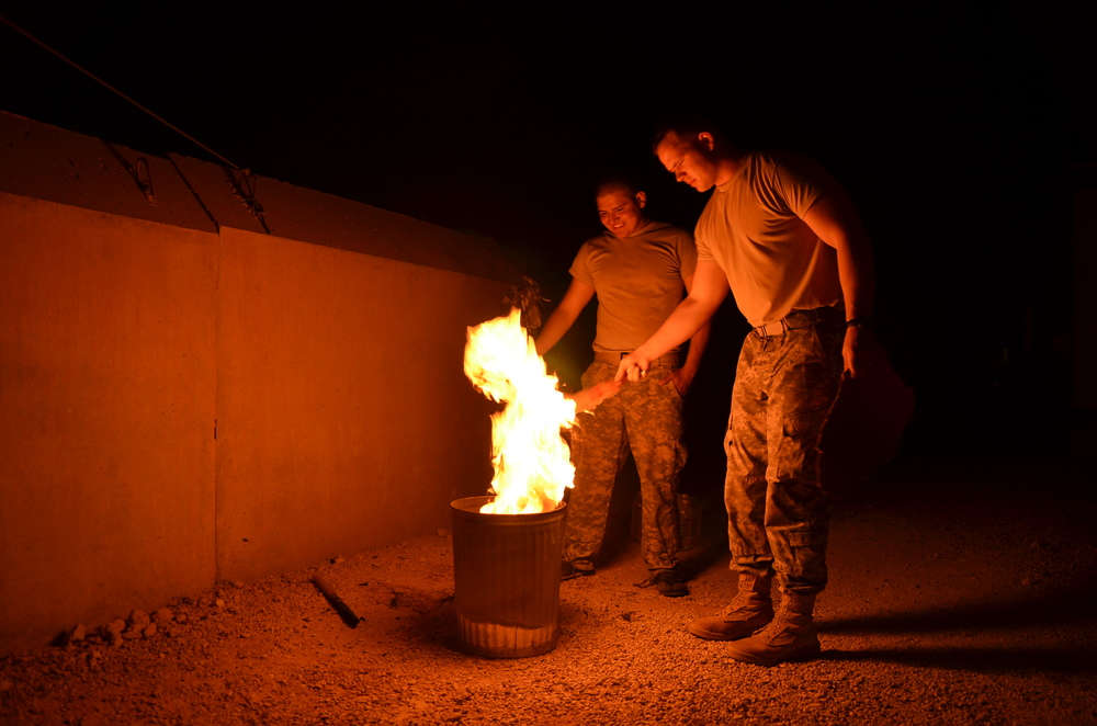 Army privates burn personal material in preparation for leaving Al-Asad Air Base in Anbar province. Sept. 27, 2011.  Photo by Dan Zak